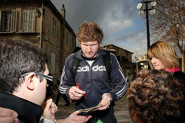 All Black Adam Thomson signs autographs during a day of sightseeing in Avignon, about 85kms from Marseille where the team will play France.