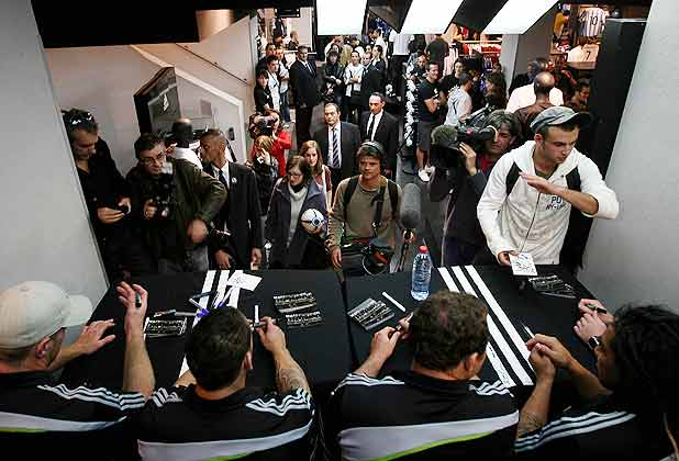 Fans gather as All Blacks Brad Thorn, Tony Woodcock, Luke McAlister, Ma'a Nonu, Jimmy Cowan and Dan Carter attend a shirt signing session at an adidas store in Marseille.