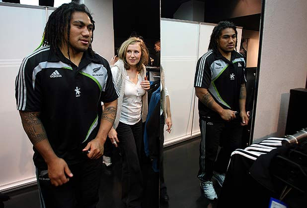 Ma'a Nonu is watched by a fan as he attends an All Blacks shirt signing session in an adidas store in Marseille.