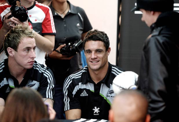 Jimmy Cowan and Dan Carter at an All Blacks shirt signing session in an adidas store in Marseille.