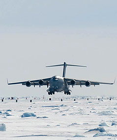 SAFE LANDING: A United States Globemaster touches down at McMurdo Sound yesterday carrying family members of those who died on Mt Erebus in 1979.