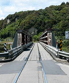 REPLACED: The original 120-year-old wooden, single lane bridge which crossed the Arahura River for both State Highway 6 and the Hokitika branch railway line.