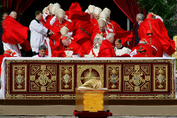 Cardinals' cassocks are blown by a wind