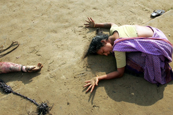A woman mourns the death of her relative