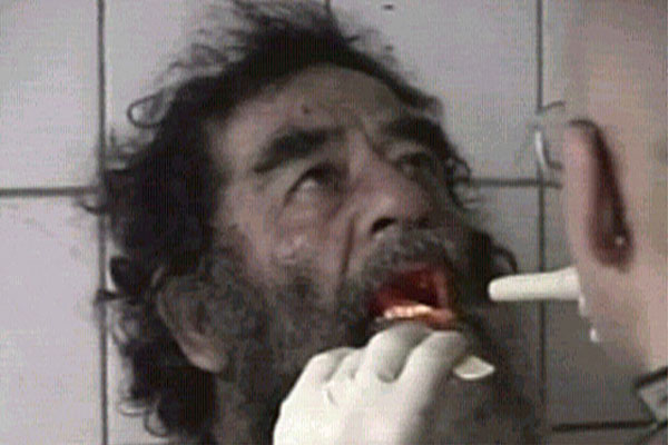 Saddam Hussein is filmed after his capture near his home town of Tikrit in Iraq