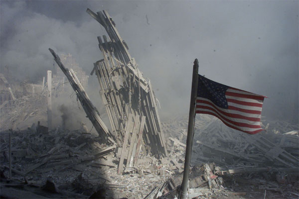 An American flag flies near the base of the destroyed World Trade Centre