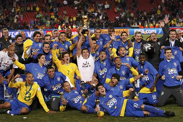 The Brazil squad celebrates beating the USA in the Confederations Cup final.