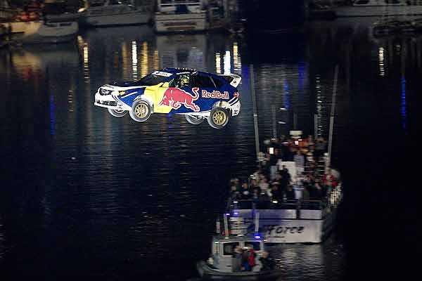 Travis Pastrana of the US soars 82 metres to break the world record for longest distance jump in a rally car during the Red Bull: New Year. No Limits event in Long Beach, California.