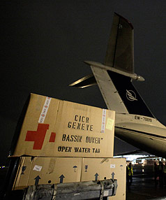 AID JAM: International Red Cross staff load emergency supplies bound for Haiti into a Ilyushin 76 aircraft at Cointrin airport in Geneva.