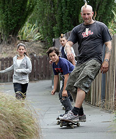 NEW MAN: ADHD sufferer Tim Webb, plays with his children Reha, 12, left, Tanchoz, 9, and Darius, 14, has been trialling micronutrients treatment.