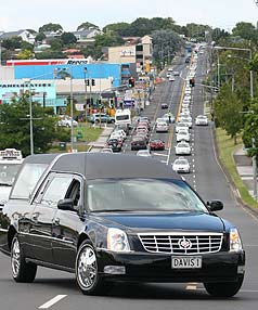 CORTEGE: The hearse carrying Mr Mohini's body arrived at Waikumete Cemetery in Auckland with a cavalcade of 300 taxis behind it.
