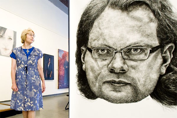 Gallery director Avenal McKinnon stands next to a portrait of Clayton Weatherston