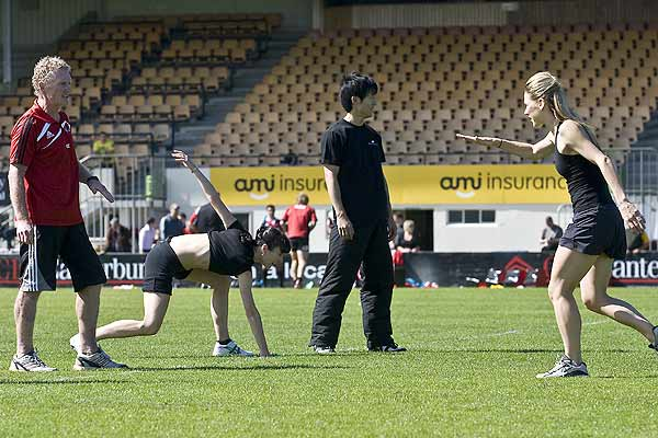 Crusaders fitness trainer Ashley Jones works with Clytie Campbell, Qi Huan and Lucy Balfour from the Royal New Zealand Ballet during the Crusaders training at Rugby Park, Christchurch.