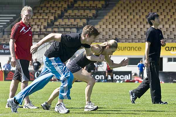 Crusaders fitness trainer Ashley Jones works with Jaered Glavin, Lucy Balfour  and Qi Huan from the Royal New Zealand Ballet company during the Crusaders training at Rugby Park, Christchurch.