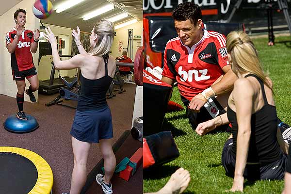 Lucy Balfour from the Royal New Zealand Ballet helps Sean Maitland (left) in the weights room and then gives Dan Carter some stretching tips during a Crusaders training session at Rugby Park, Christchurch.