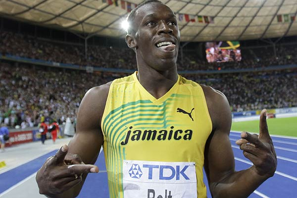 Usain Bolt of Jamaica celebrates after winning the men's 100 metres final at the world athletics championships at the Olympic stadium in Berlin August 16, 2009.