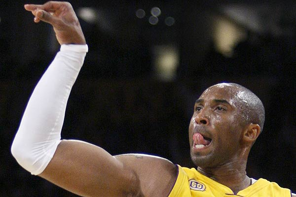 Los Angeles Lakers Kobe Bryant watches after releasing his three-point shot against the Denver Nuggets during Game 2 of their NBA basketball playoff series in Los Angeles.