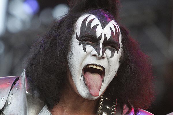 Kiss bassist Gene Simmons pokes his tongue out during a concert after the Melbourne F1 Grand Prix.