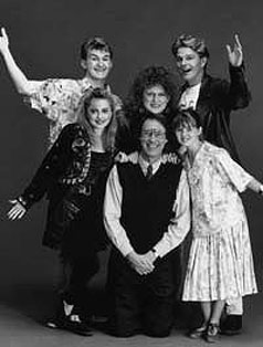 The cast of the sitcom Hey Dad!, including Robert Hughes, wearing a tie, and Sarah Monaghan, right.