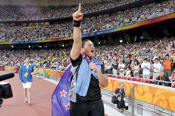 Valerie Vili flies the NZ flag after winning the Gold Medal in the Women's Shot Put at the the 2008 Olympic Games in Beijing.