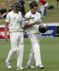Chris Martin and Tim Southee