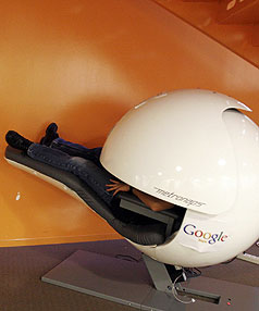 RELAXING GOOGLE STYLE: An employee takes time out in a nap pod, which blocks out light and sound.