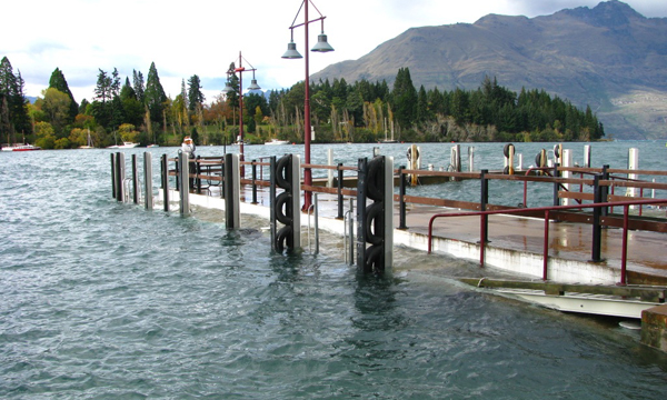 A flooded jetty on Queenstown's waterfront.
