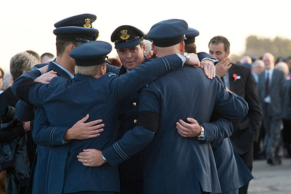 STANDING TOGETHER: Servicemen embrace at the funeral at Ohakea airbase.