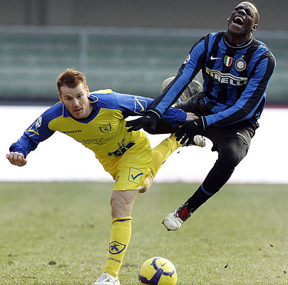 Inter Milan Mario Balotelli (right) challenges Michele Marcolini of Chievo during their Serie A football match at Bentegodi stadium in Verona.