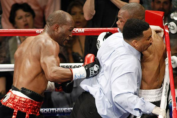 Referee Tony Weeks (centre) gets hit by a punch from Bernard Hopkins (left) of the US after Hopkins and compatriot Roy Jones Jr., continued to fight after the end of the sixth round of their light heavyweight fight at the Mandalay Bay Events Center in Las Vegas.