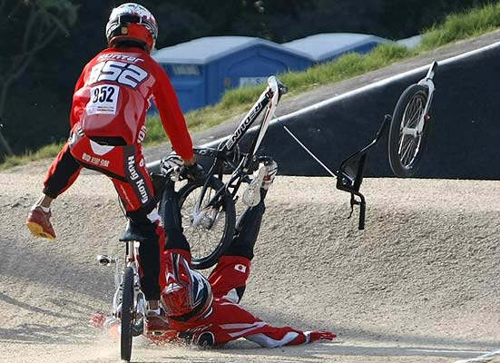 Hong Kong's Alex Hunter (left) crashes with Japan's Masahiro Sampei in the BMX men's heats during the East Asian Games in Hong Kong.