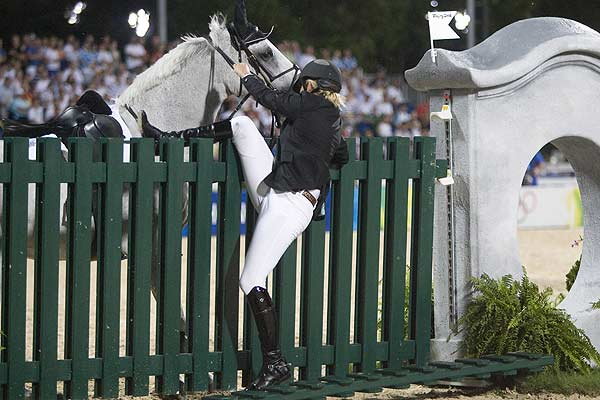 New Zealand's Katie McVean falls off Forest after he refused to jump a fence during the equestrian jumping individual first qualifier at the Beijing 2008 Olympic Games.