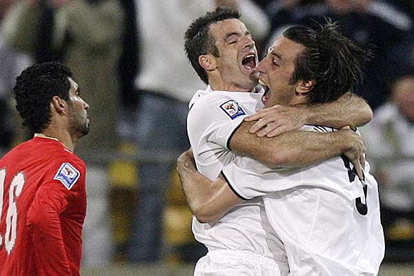 All Whites captain Ryan Nelsen (centre) celebrates with teammate Ivan Vicelich after New Zealand had beaten Bahrain 1-0 to qualify for the 2010 football World Cup.