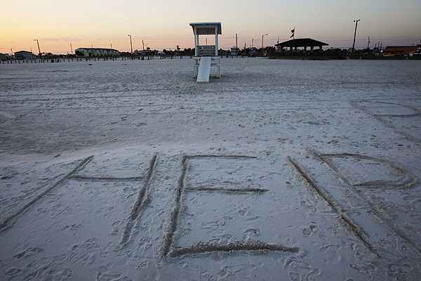 Help written on beach