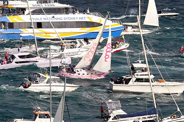 Jessica Watson, aboard her yacht Ella's Pink Lady, sails into Sydney harbour.