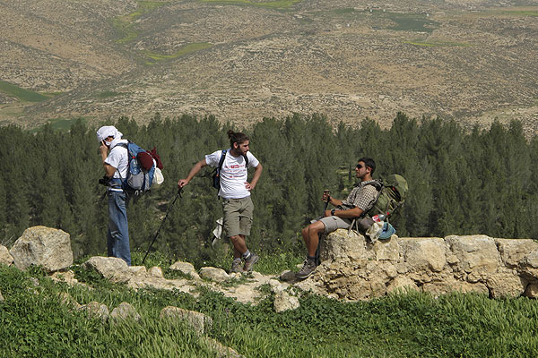 AND HE RESTED: Israeli hikers stop during a day of hiking along the Israel Trail in Yatir forest, southern Israel.