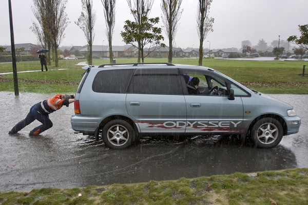 Motorists try their luck at getting through the flooded Northwood Boulevard/O'Neill Ave roundabout.