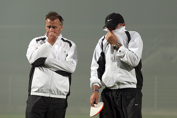 All Whites assistant coach Brian Turner (left) and goalkeeping coach Clint Gosling struggle to breathe in smoggy conditions for the team's first training run in South Africa.