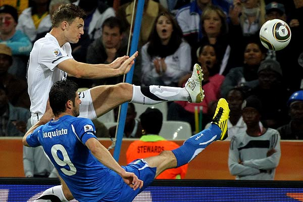 All Whites' Tommy Smith kicks a ball clear of Italy's Vincenzo Iaquinta during their football World Cup match.