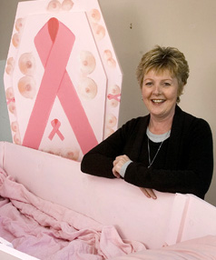 MESSAGE IN PINK: Pam Hermansen, who has terminal breast cancer, has arranged her own funeral and had artist Lyn Taylor decorate her coffin.
