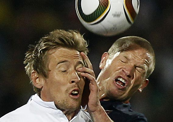 England's Peter Crouch (left) and Jay DeMerit of the US fight for the ball during the 2010 World Cup football match at Royal Bafokeng stadium in Rustenburg.