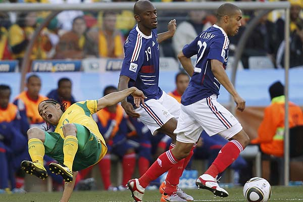 France's Gael Clichy (right) runs off with the ball from South Africa's Steven Pienaar during their 2010 World Cup Group A football match at Free State stadium in Bloemfontein.