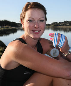 SWEET WATER SUCCESS: Waihopai Rowing Club's Genevieve Behrent back at the Oreti River with the silver medal that she won at the world under-23 rowing championships in Belarus on Sunday morning.