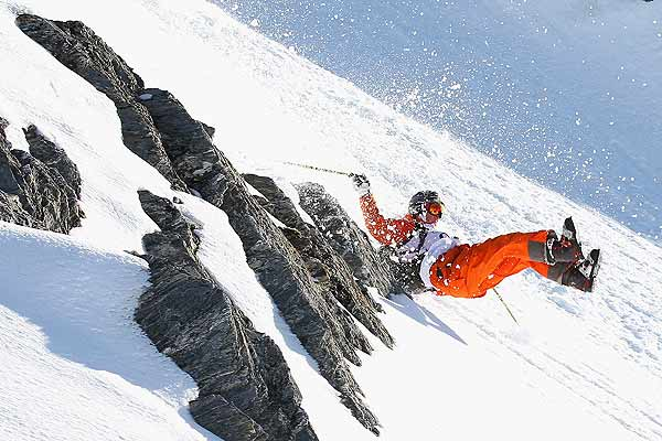 Luke Potts of Great Britain loses his skis during the Extreme Day of the World Heli Challenge at Mount Aspiring National Park, near Wanaka, New Zealand.