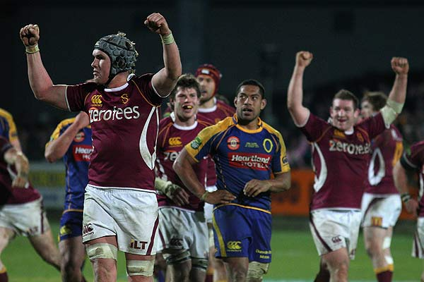 Josh Bekhuis of Southland (left) and teammates celebrate retaining the Ranfurly Shield round two ITM Cup match at Rugby Park, Invercargill.