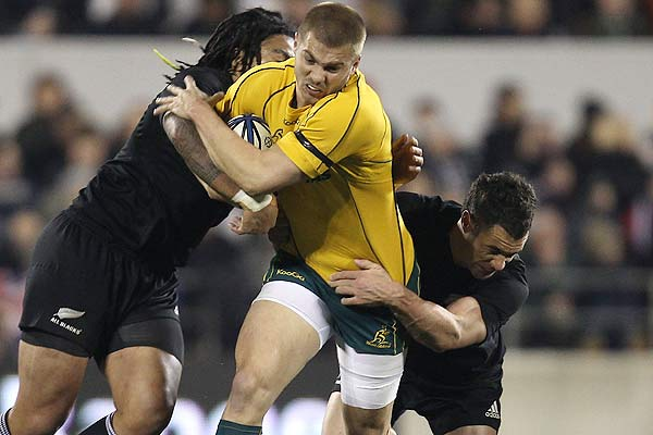 Australia's Drew Mitchell by Ma'a Nonu and Dan Carter during the Tri-Nations Bledisloe Cup match in Christchurch.