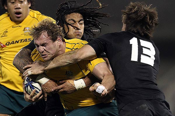 Australia's Rocky Elsom is hit hard by Richie McCaw, Ma'a Nonu and Conrad Smith during the Tri-Nations Bledisloe Cup match in Christchurch.