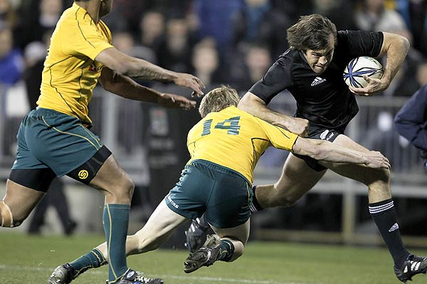 New Zealand's Conrad Smith pushes off Australia's James O'Connor to score during the Tri-Nations Bledisloe Cup match in Christchurch.
