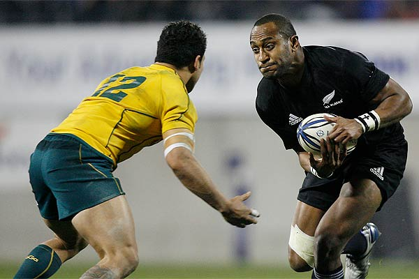 All Blacks winger Joe Rokocoko tries to step Australia's Anthony Faingaa during the Bledisloe Cup test in Christchurch.
