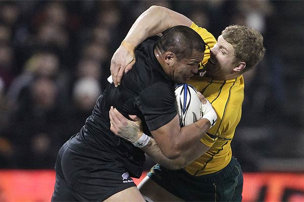 New Zealand's Keven Mealamu tries to wrestle his way past Australia's David Pocock during the Bledisloe Cup match in Christchurch.